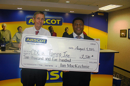 Ian MacKechnie presents check to CDC