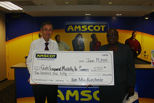 Ian MacKechnie presents donation to Girls Empowered