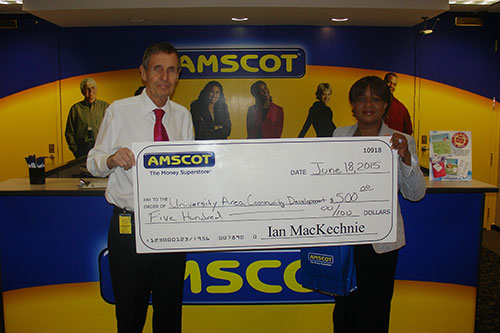 Ian MacKechnie presents donation to Community Development